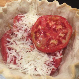 Homegrown tomatoes layered with fresh mozzarella and pesto