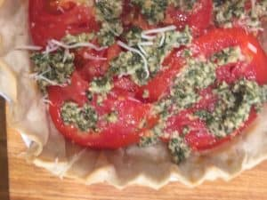 Homegrown tomato slices are layered with mozzarella and pesto sauce
