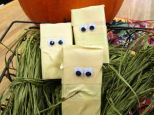 Juice boxes are wrapped in masking tape with googly eyes to look like cute mummies