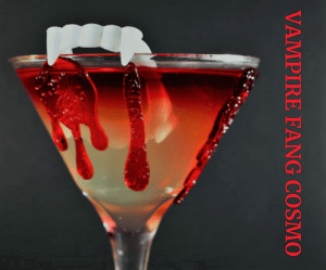 halloween drinks, vampire fang cosmo, cranberry cosmo for halloween, halloween drink that looks like blood, drink decorated with vampire fangs, fun halloween drinks that look like blood
