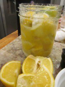 lemon quartered and juiced for a jar of preserved lemons