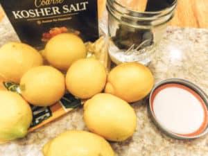 lemons, jars and salt for preserving